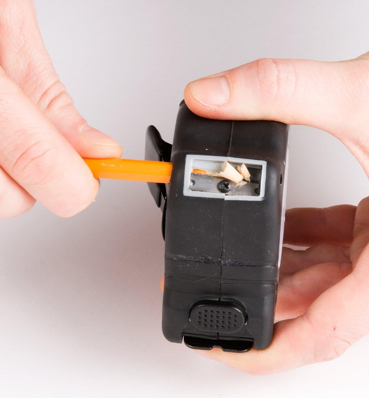 Sharpening a pencil in the built-in pencil sharpener