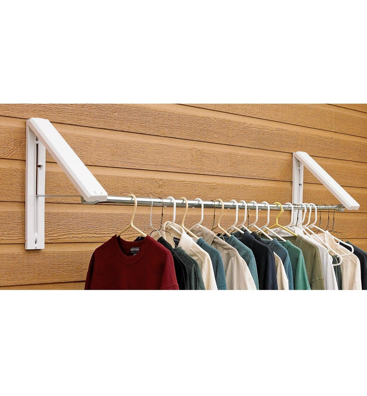Mounted 3' to 5' rack folded out, holding various clothing on hangers