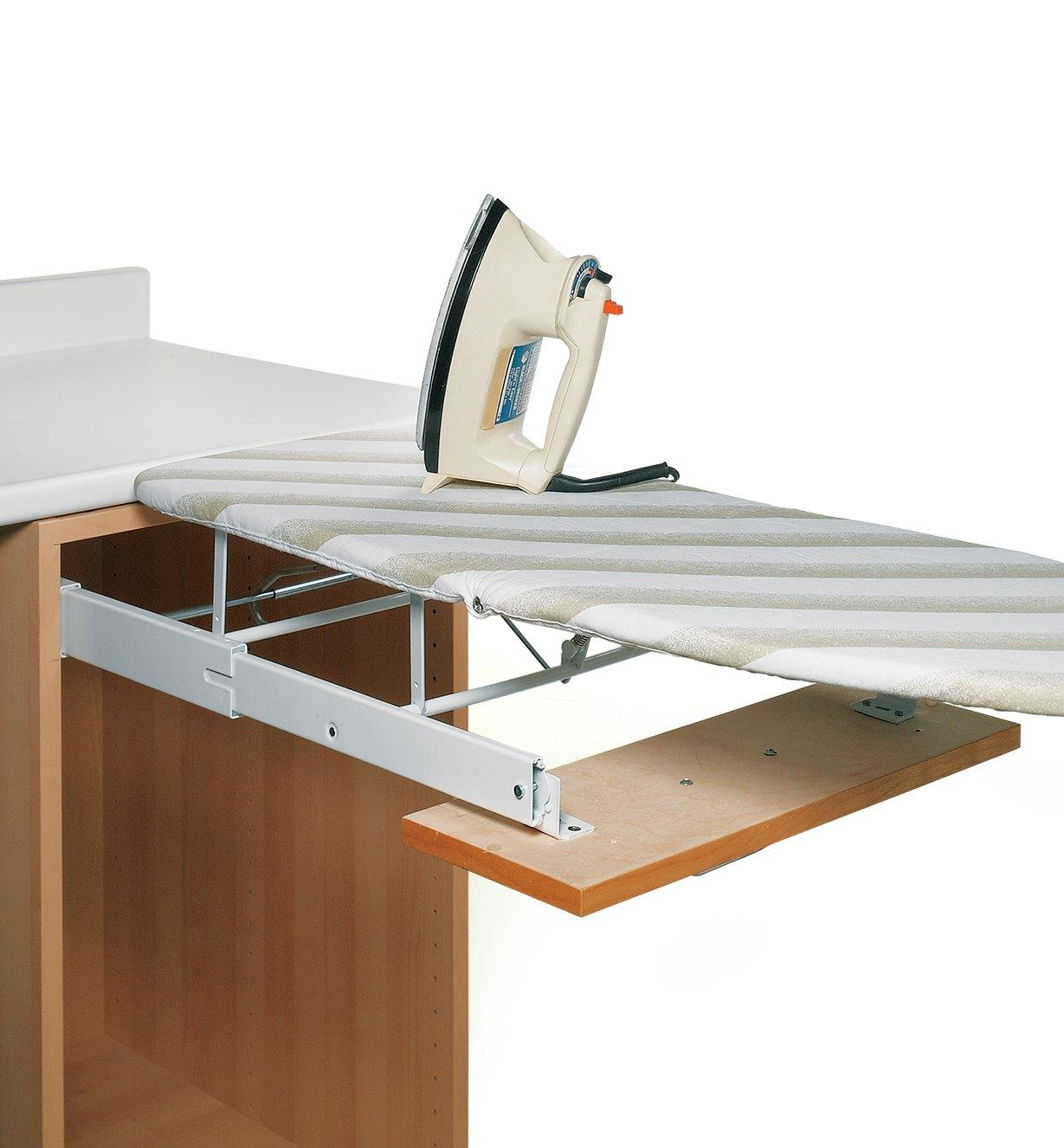Drawer-Mount Folding Ironing Board unfolded with iron sitting on top