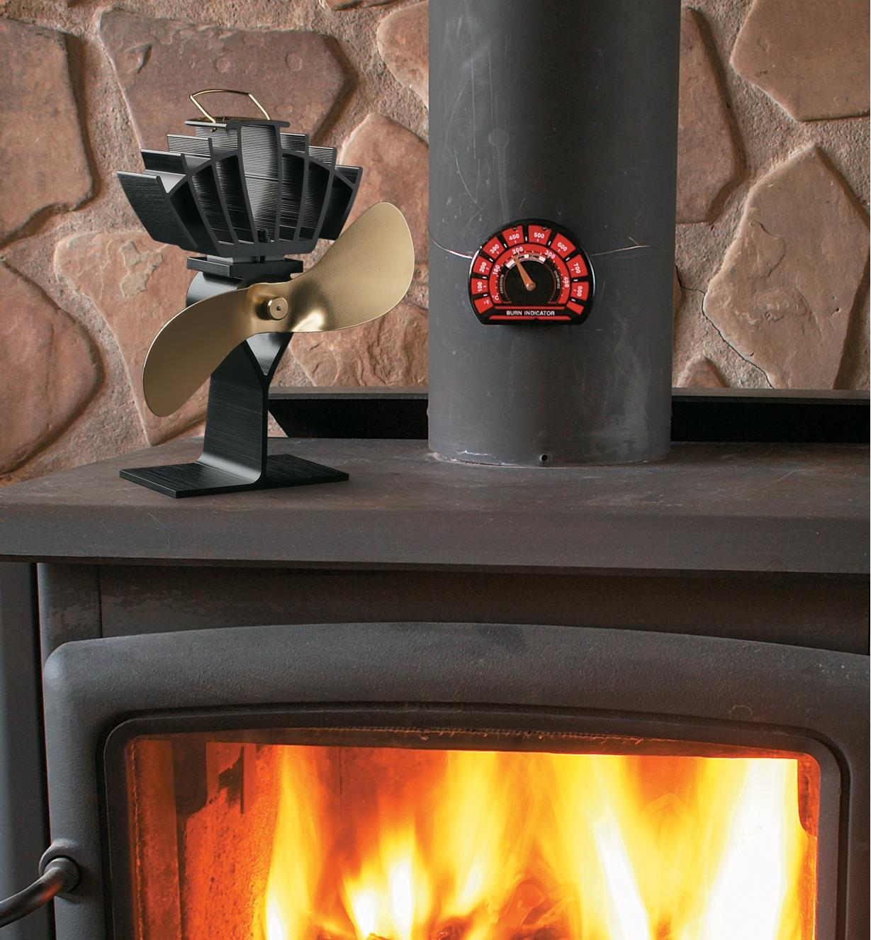 Ecofan UltrAir on a wood stove, distributing the heat of the fire