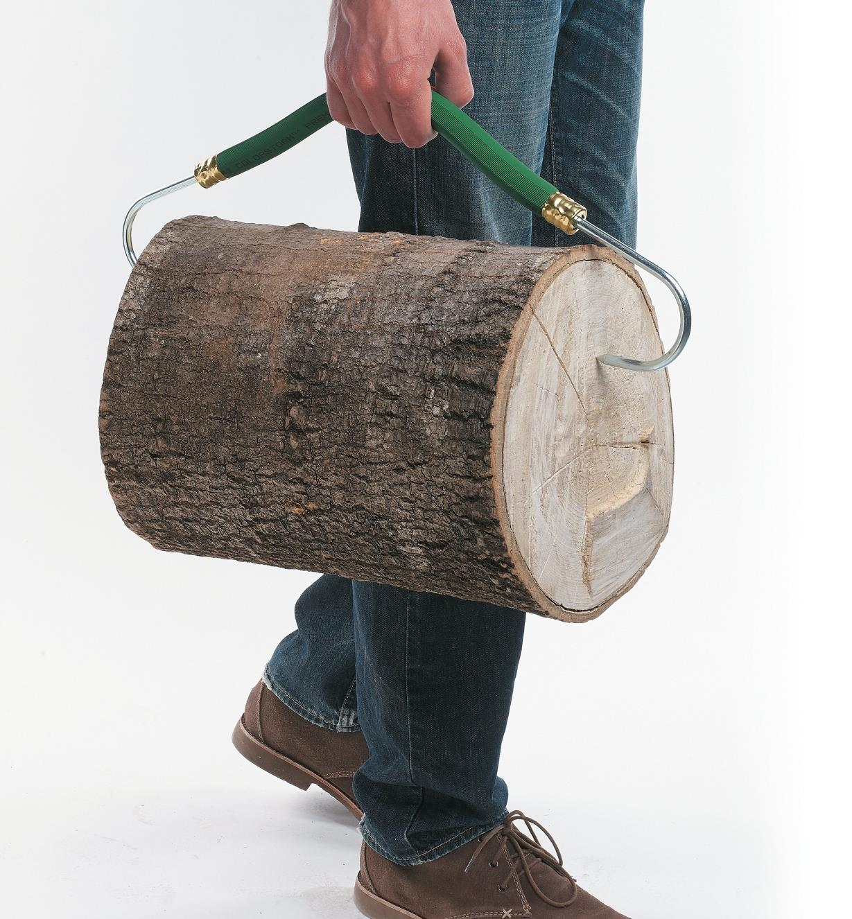 A log being carried with the Firewood Gripper