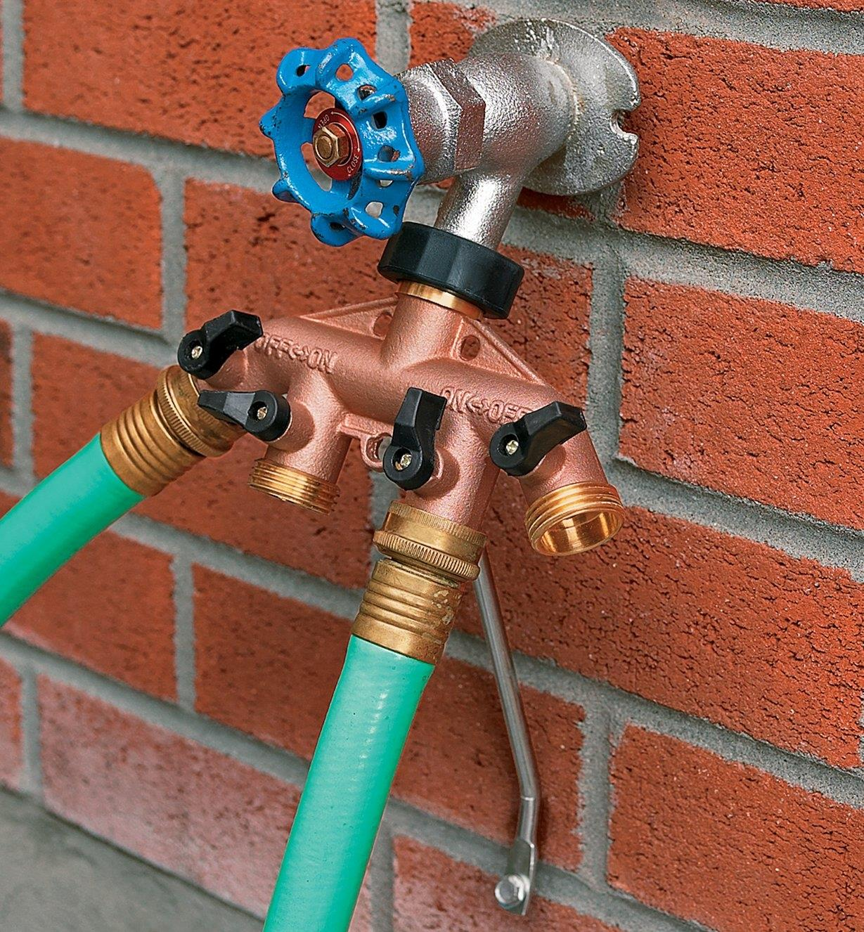 Four-Way Brass Manifold connected to faucet and two hoses