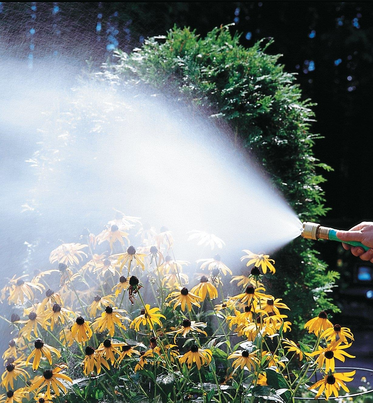Watering flowers in a garden using the fogging nozzle