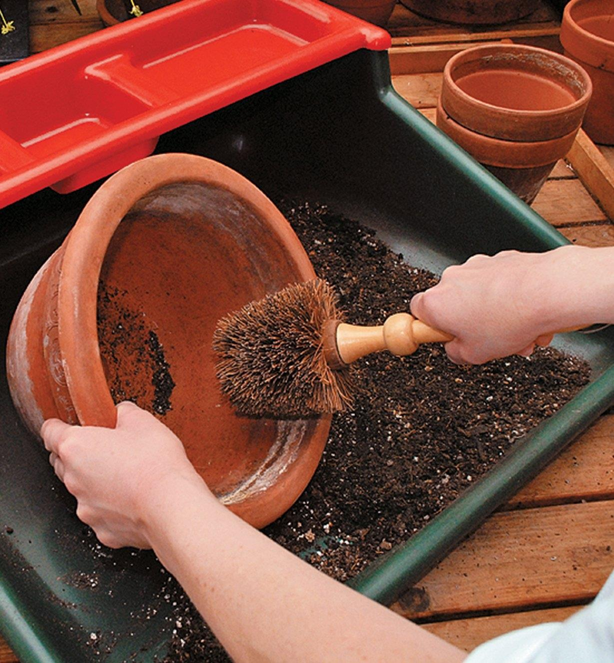 Cleaning a pot with the Heavy-Duty Brush