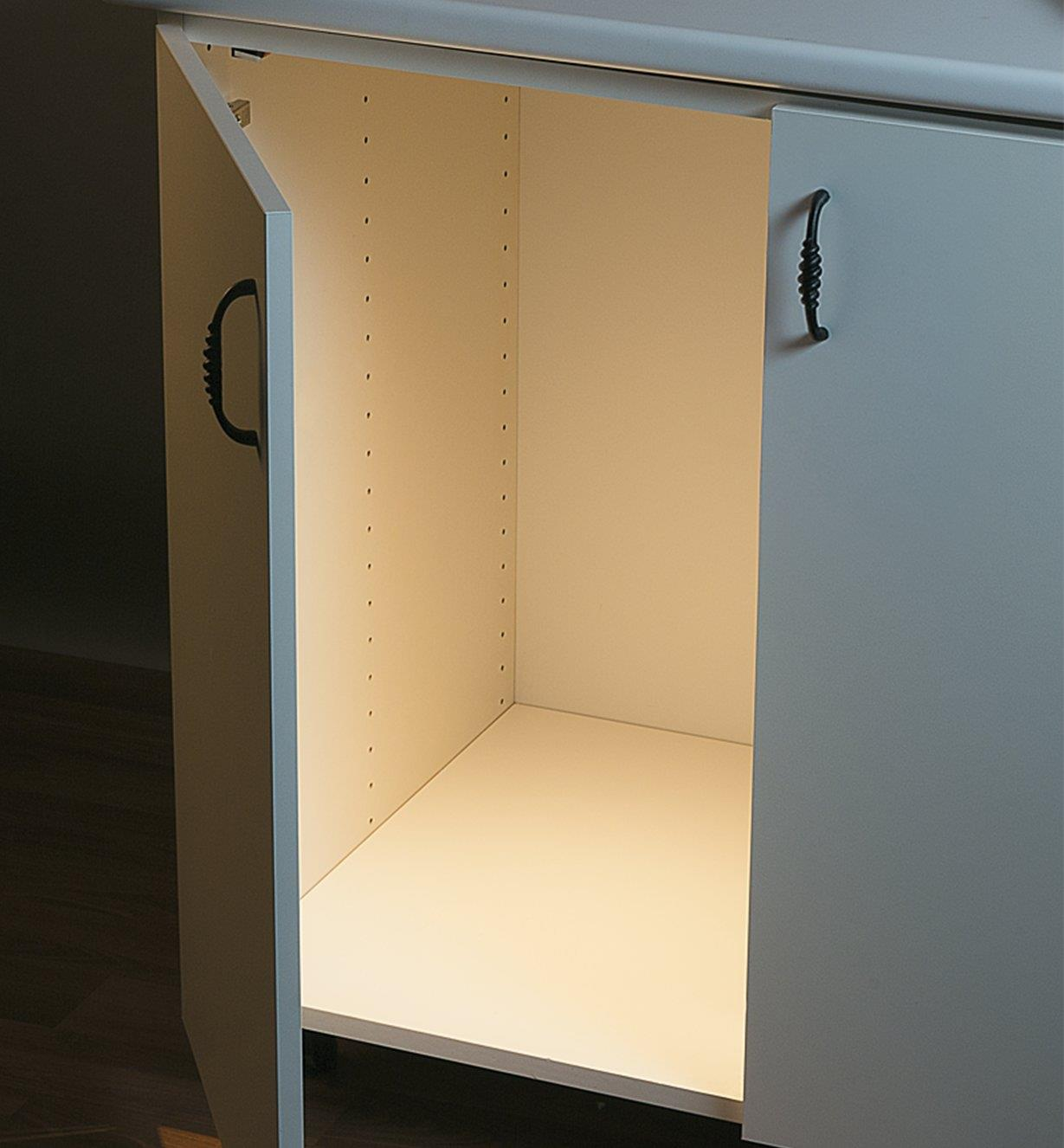 Open cabinet with light shining inside