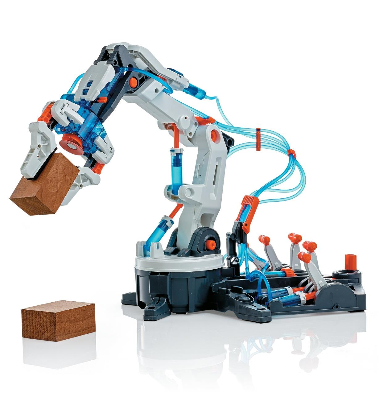 Hydraulic Robot Arm grips a wooden block