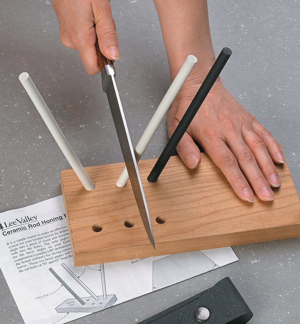 Sharpening a knife on a completed Lee Valley Ceramic Rod Honing Kit with a wooden base