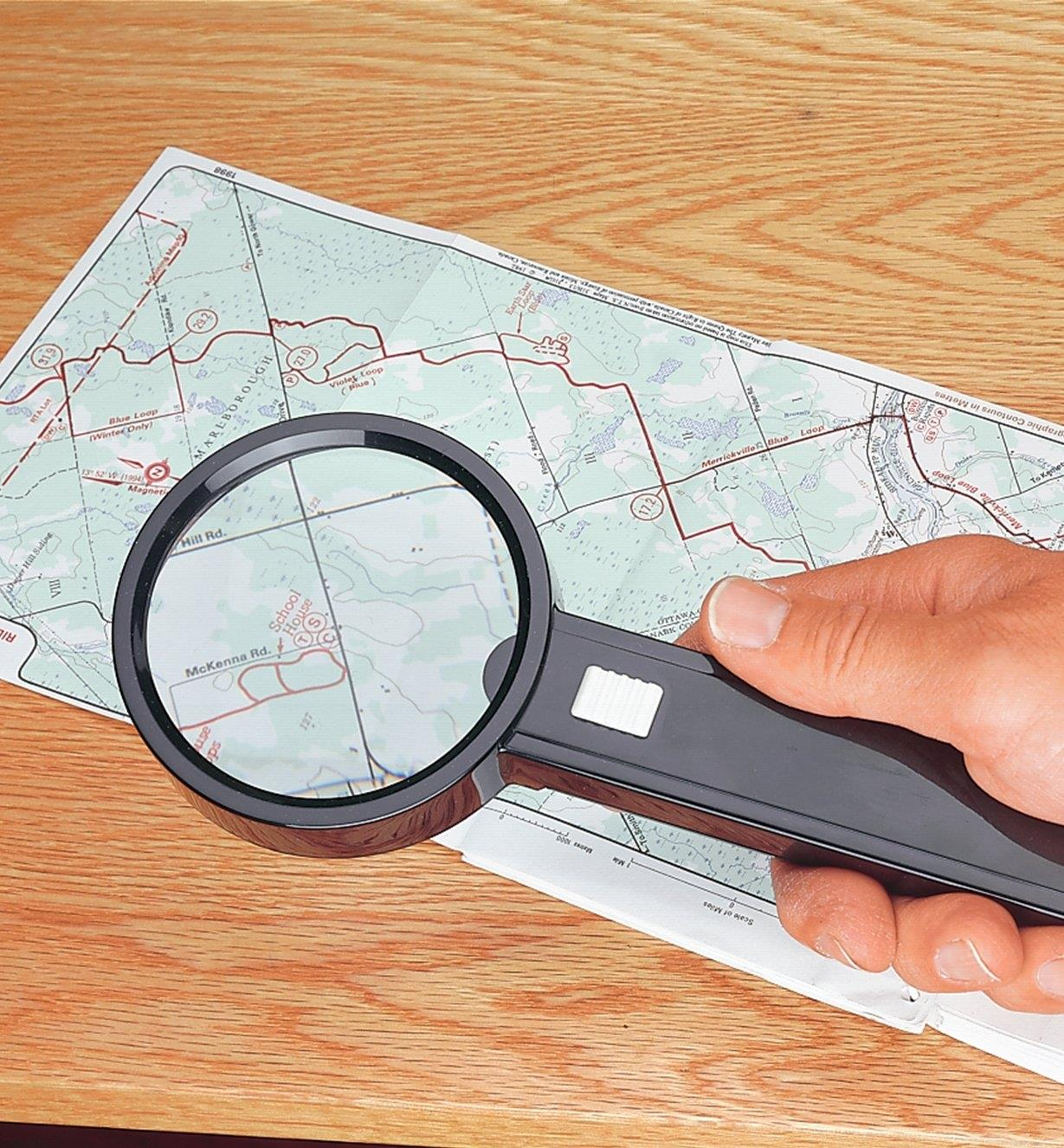 Magnifier Light being used to read a map