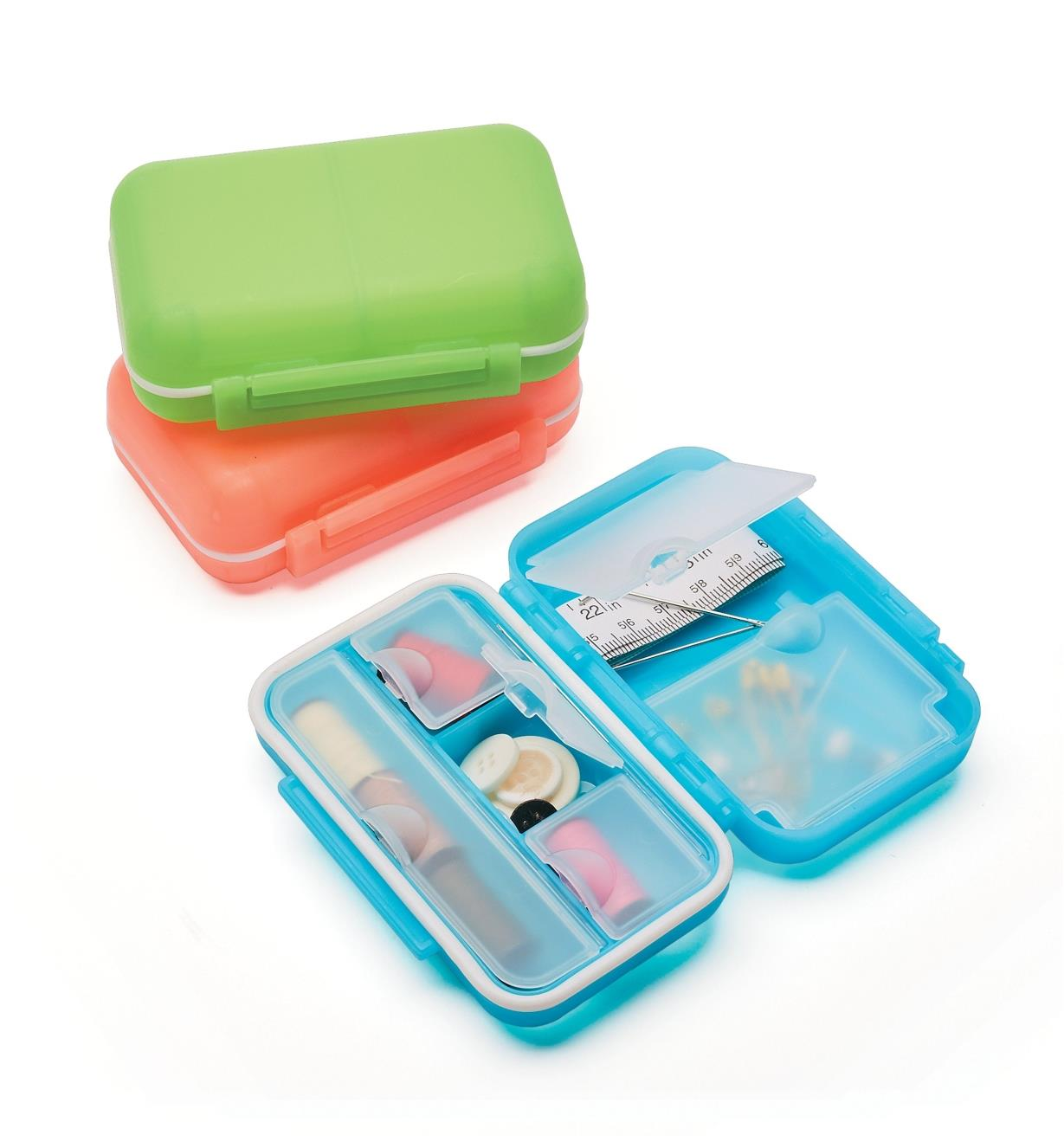 Three Locking Pocket Cases: two closed and one open, filled with sewing supplies