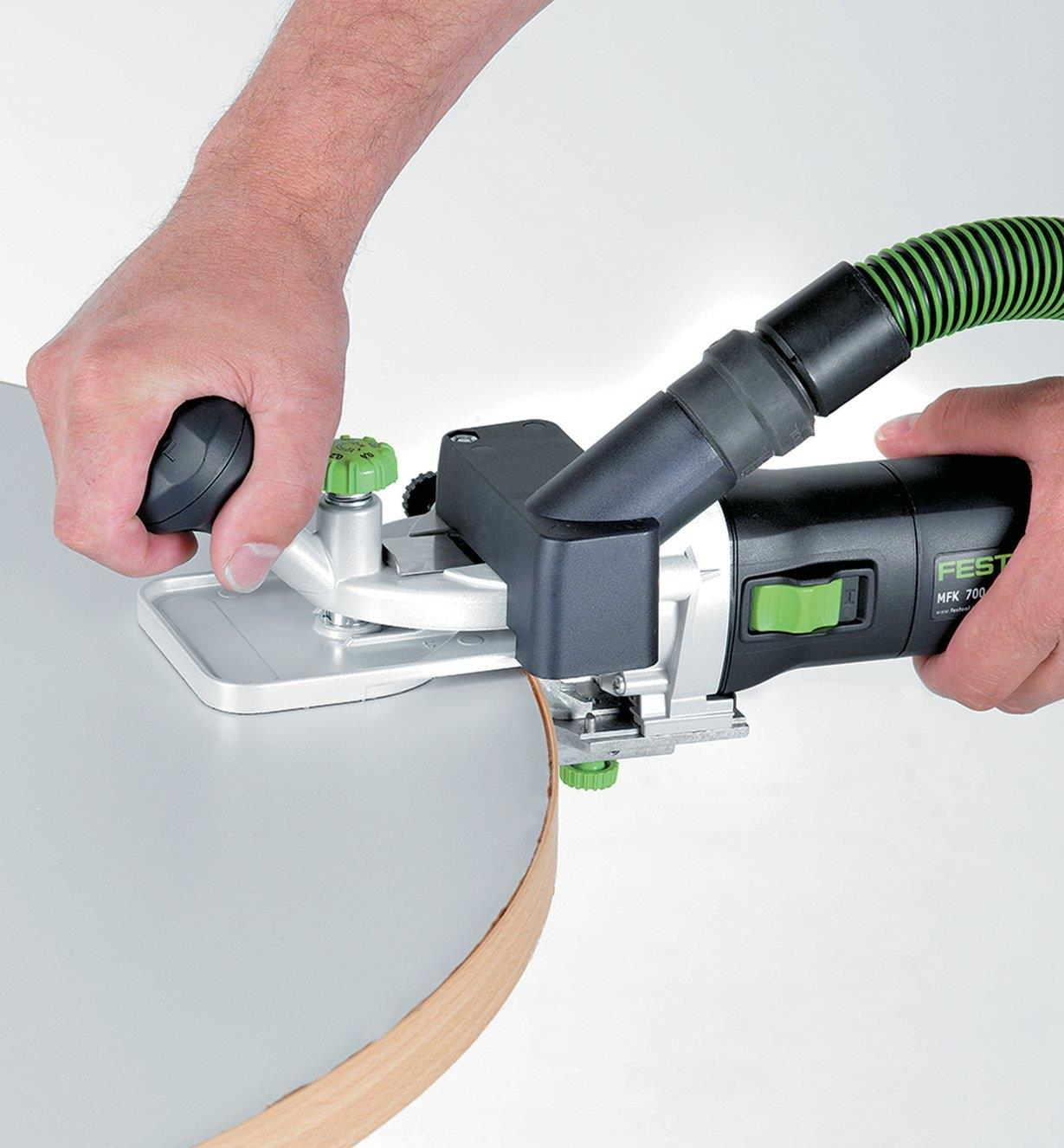 Using the router and horizontal base to trim edging on a curved tabletop