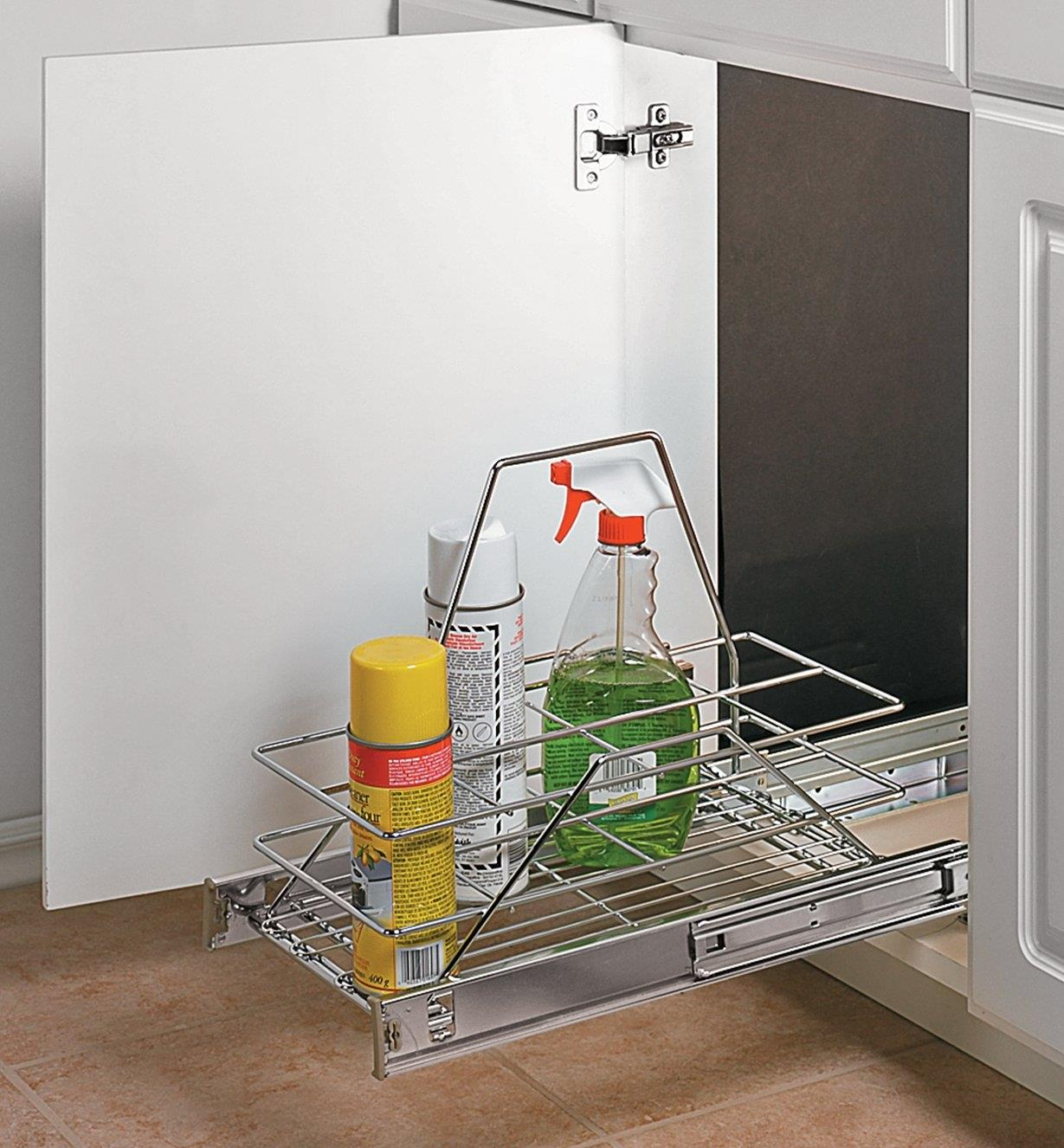 Basket Pullout mounted in a cupboard, holding cleaning supplies