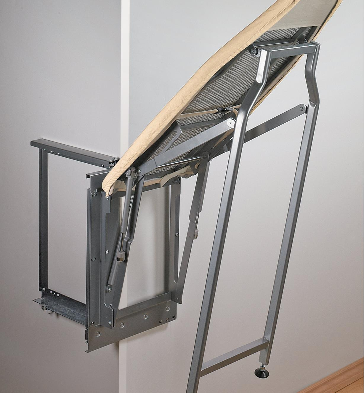 Pull-Out Ironing Board swinging downward to rest on its hinged legs