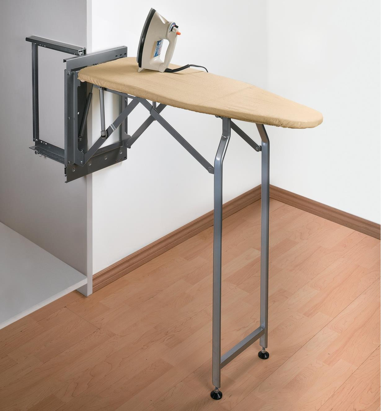 Pull-Out Ironing Board in lowered position, resting on its hinged legs