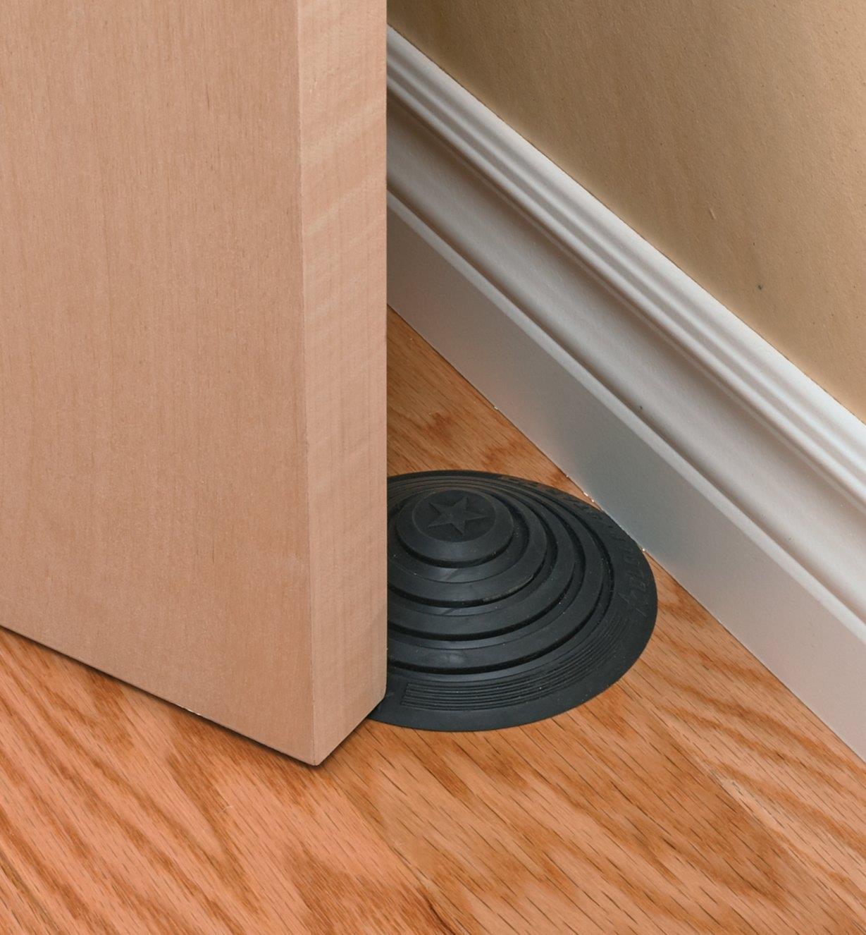 No-Stoop Doorstop preventing a door from hitting baseboards