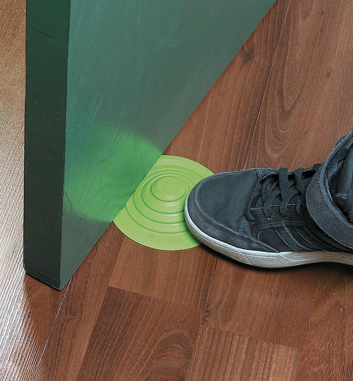 Pushing a No-Stoop Doorstop under a door