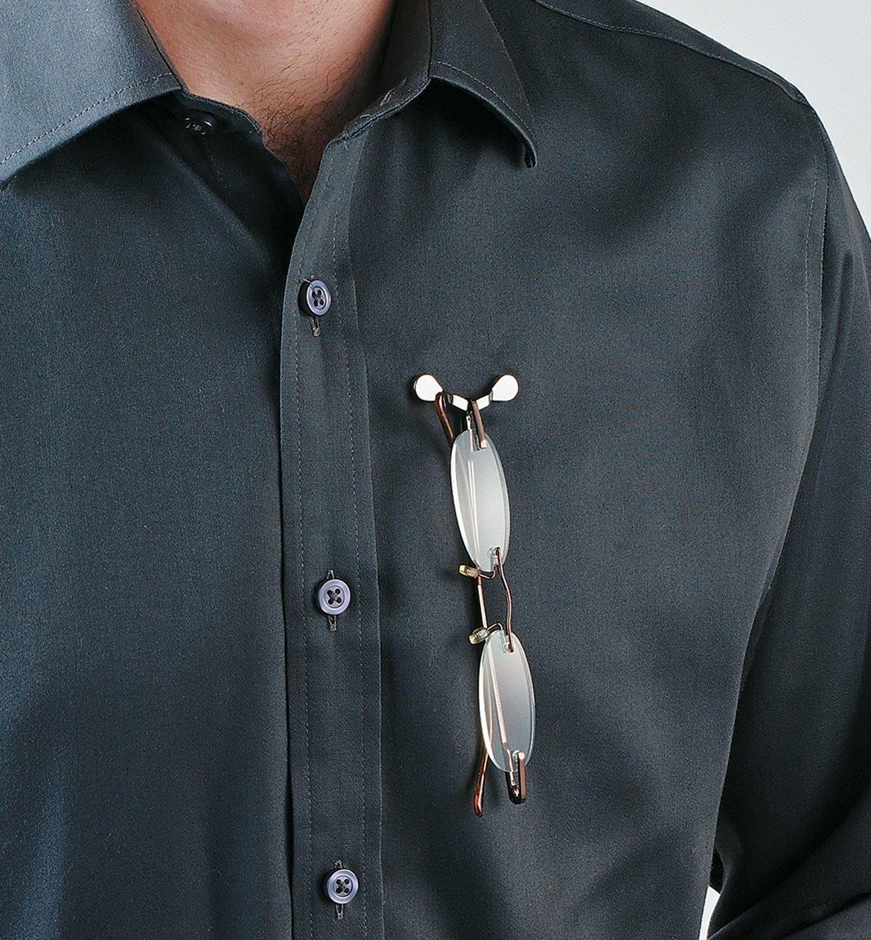 Glasses hanging from a ReadeRest attached to a button-up shirt