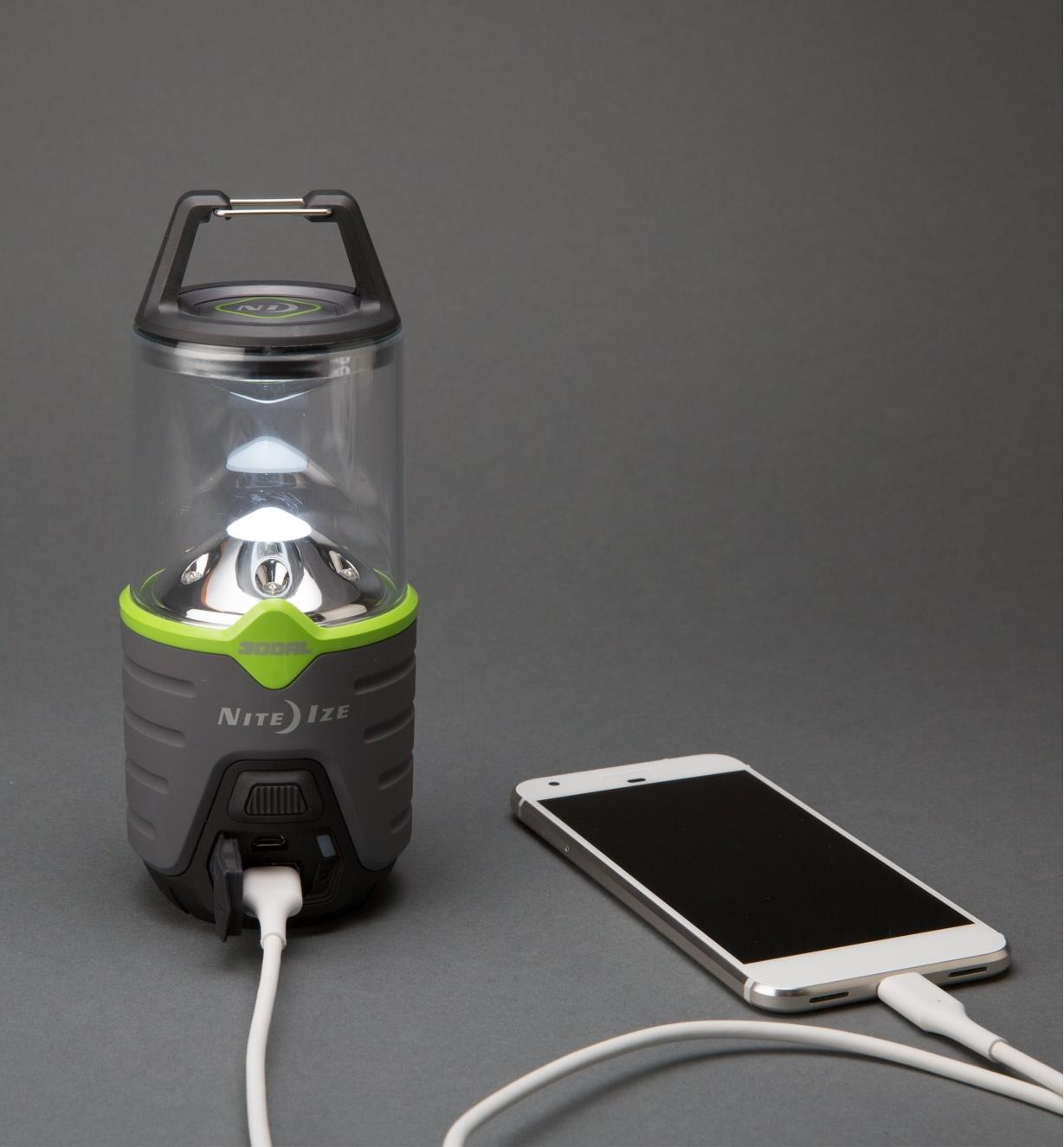 300 lm Nite Ize Rechargeable Radiant Lantern charging a smartphone
