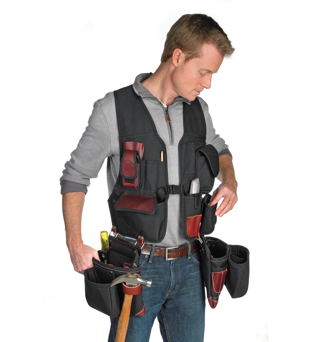 Front view of man wearing the builder's vest with clip-on tool bag and fastener bag (sold separately).