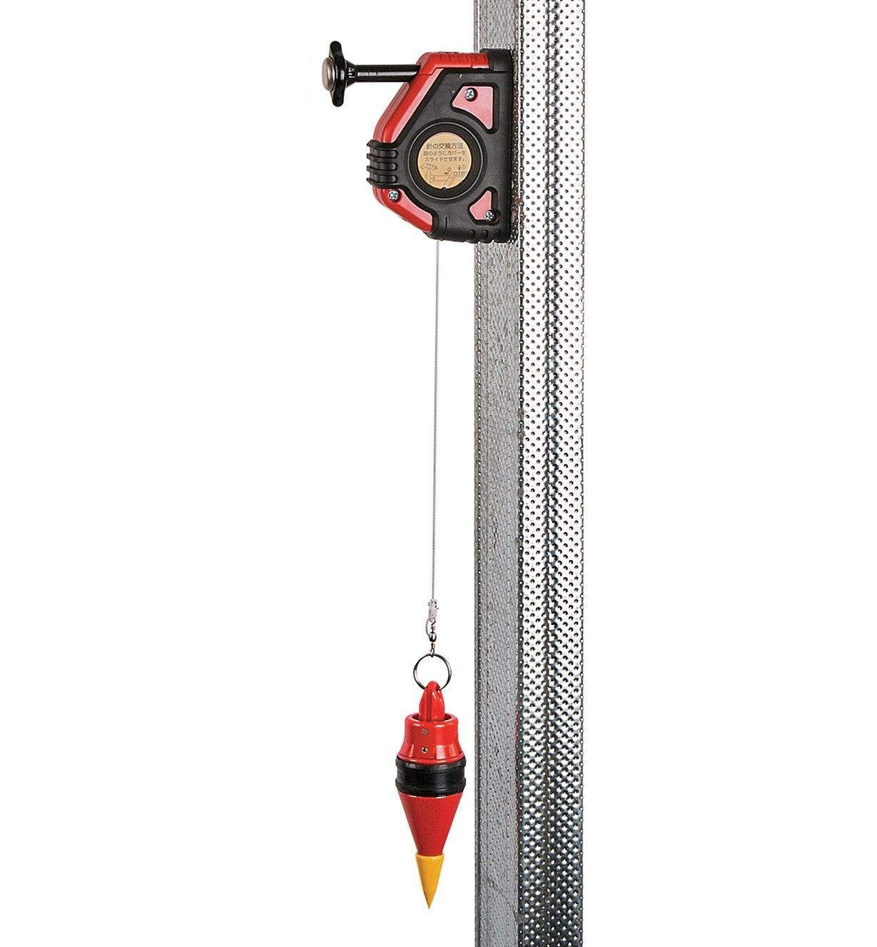 Plumb Bob & Reel attached to a steel stud