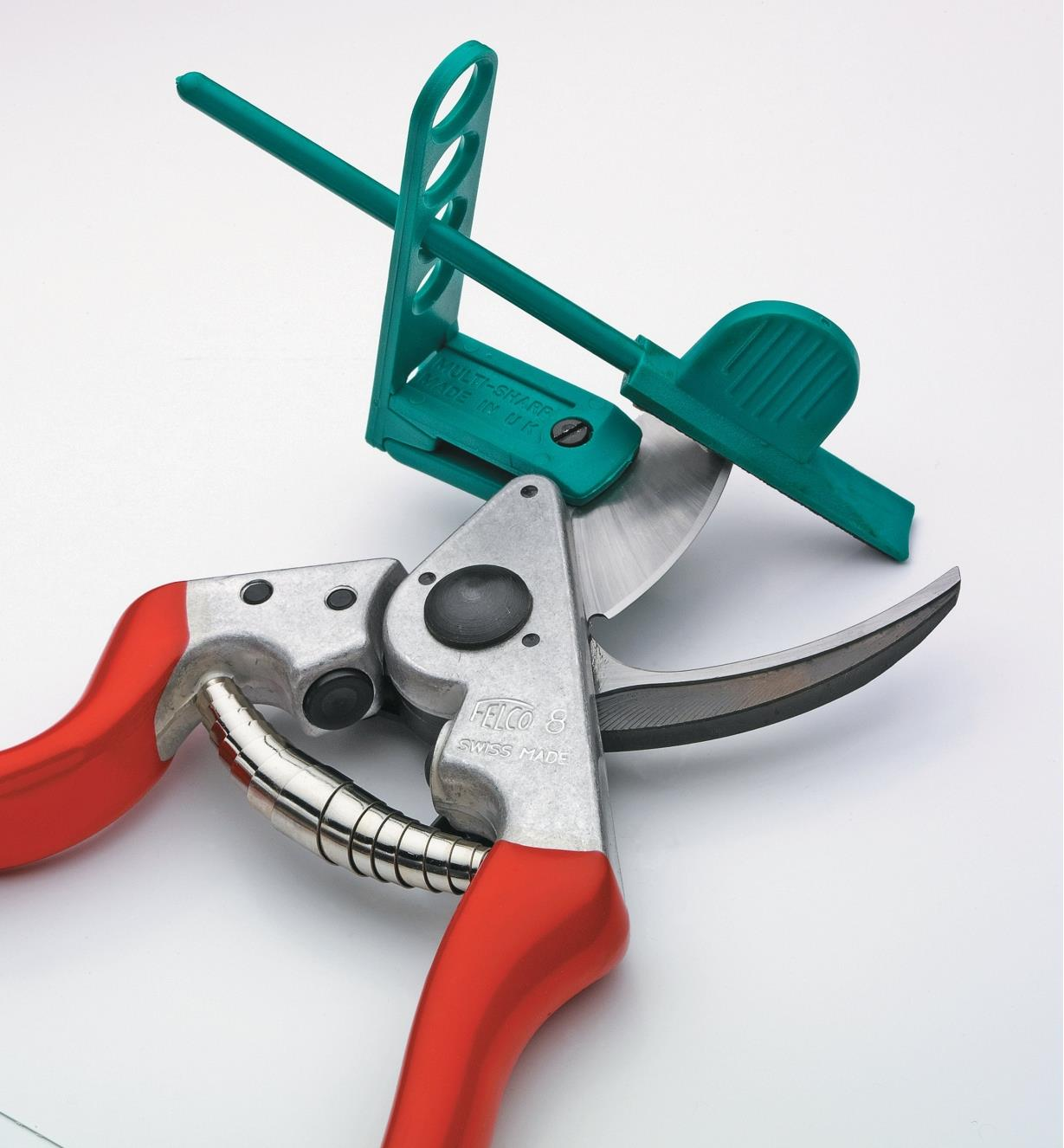 Pruner Sharpener clamped to a hand pruner blade