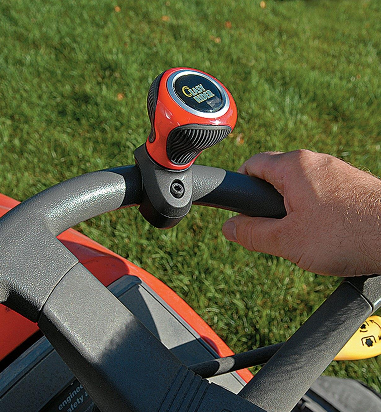 Knob mounted to a riding mower steering wheel