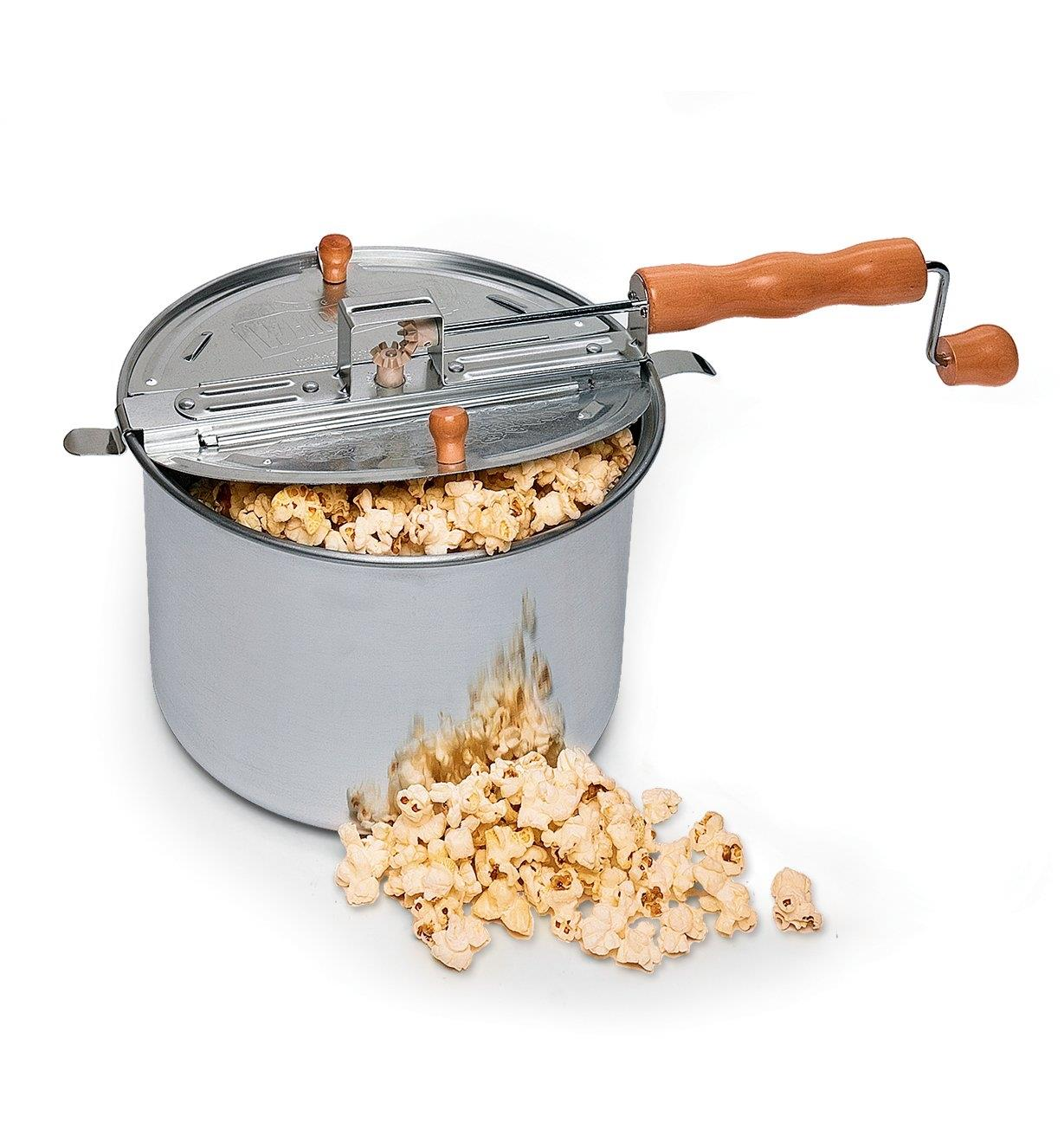 Whirley-Pop Popcorn Popper with popcorn overflowing