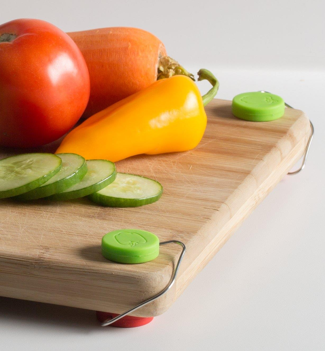 Non-Slip Feet clipped on the corners of a Cutting Board