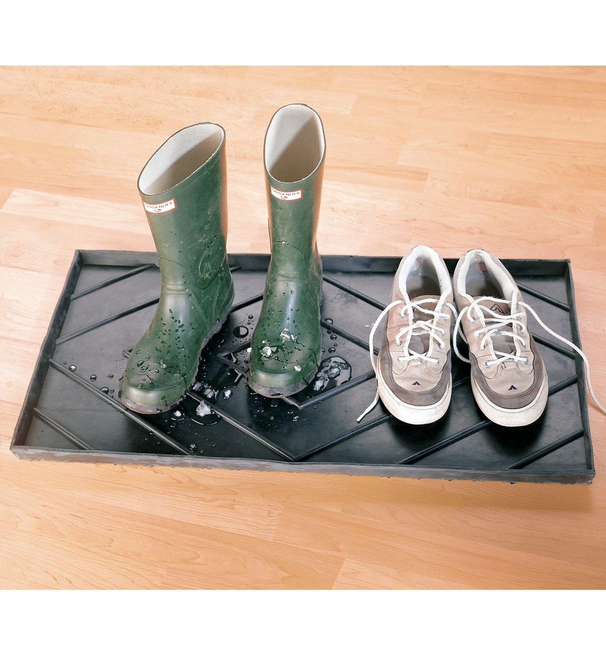 A pair of rubber boots and a pair of runners on the Rubber Boot Tray