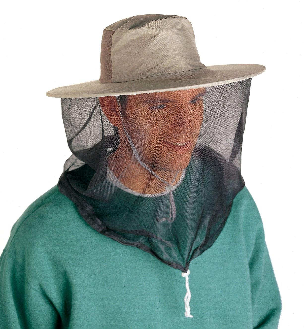 A man wearing the Pocket Hat with the mosquito head net