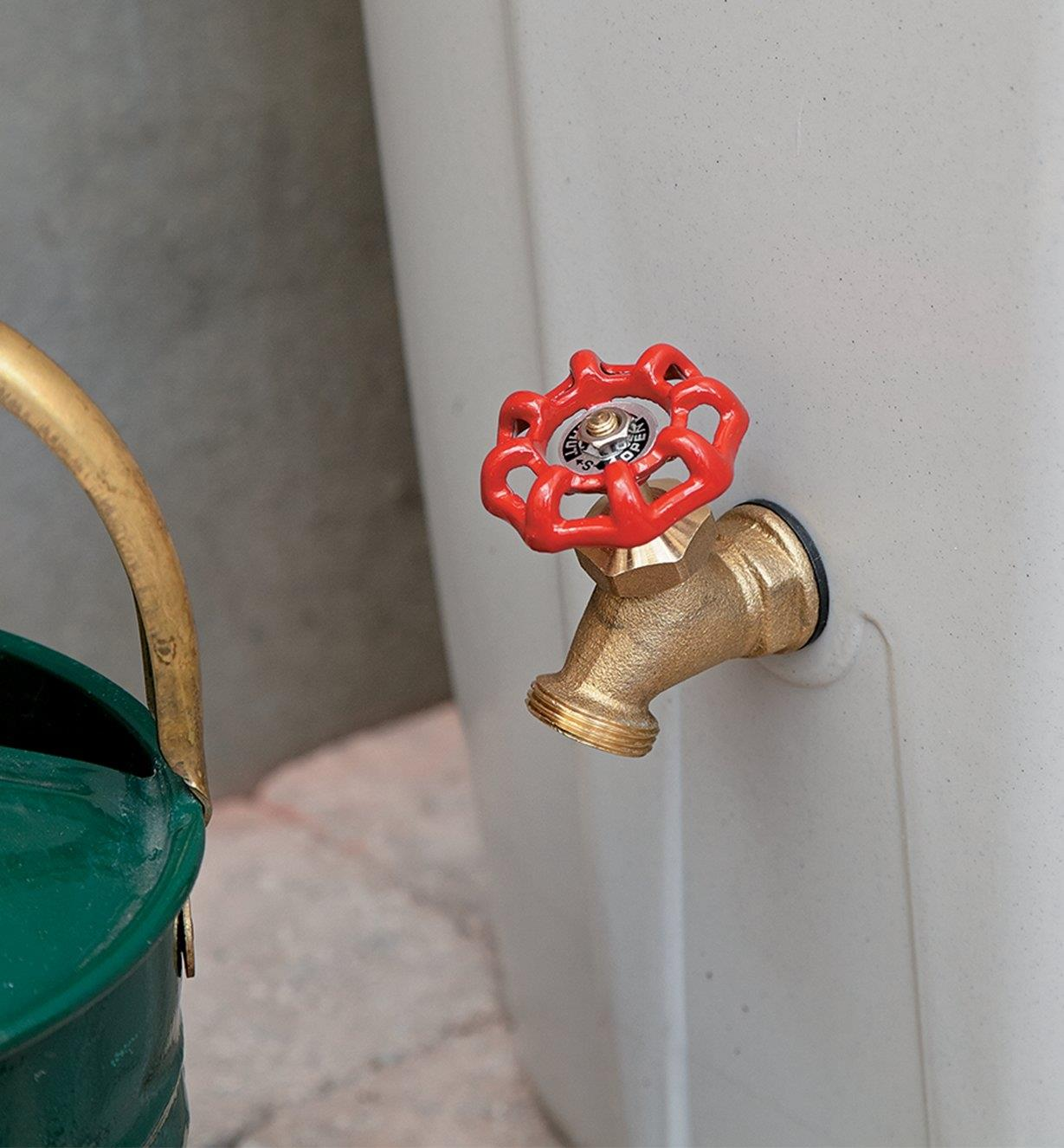 Close-up of brass faucet on side of rain barrel