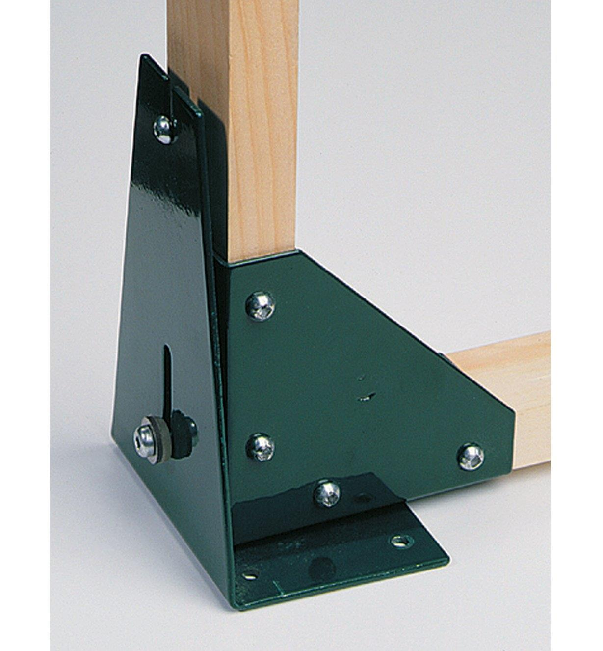 Top Kit corner bracket and hinge fastened to wood