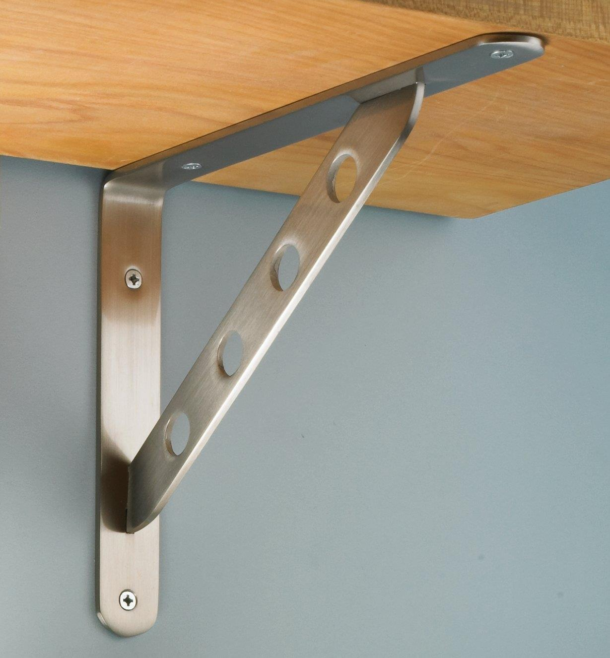 Flat Steel Shelf Bracket mounted under a shelf on a wall