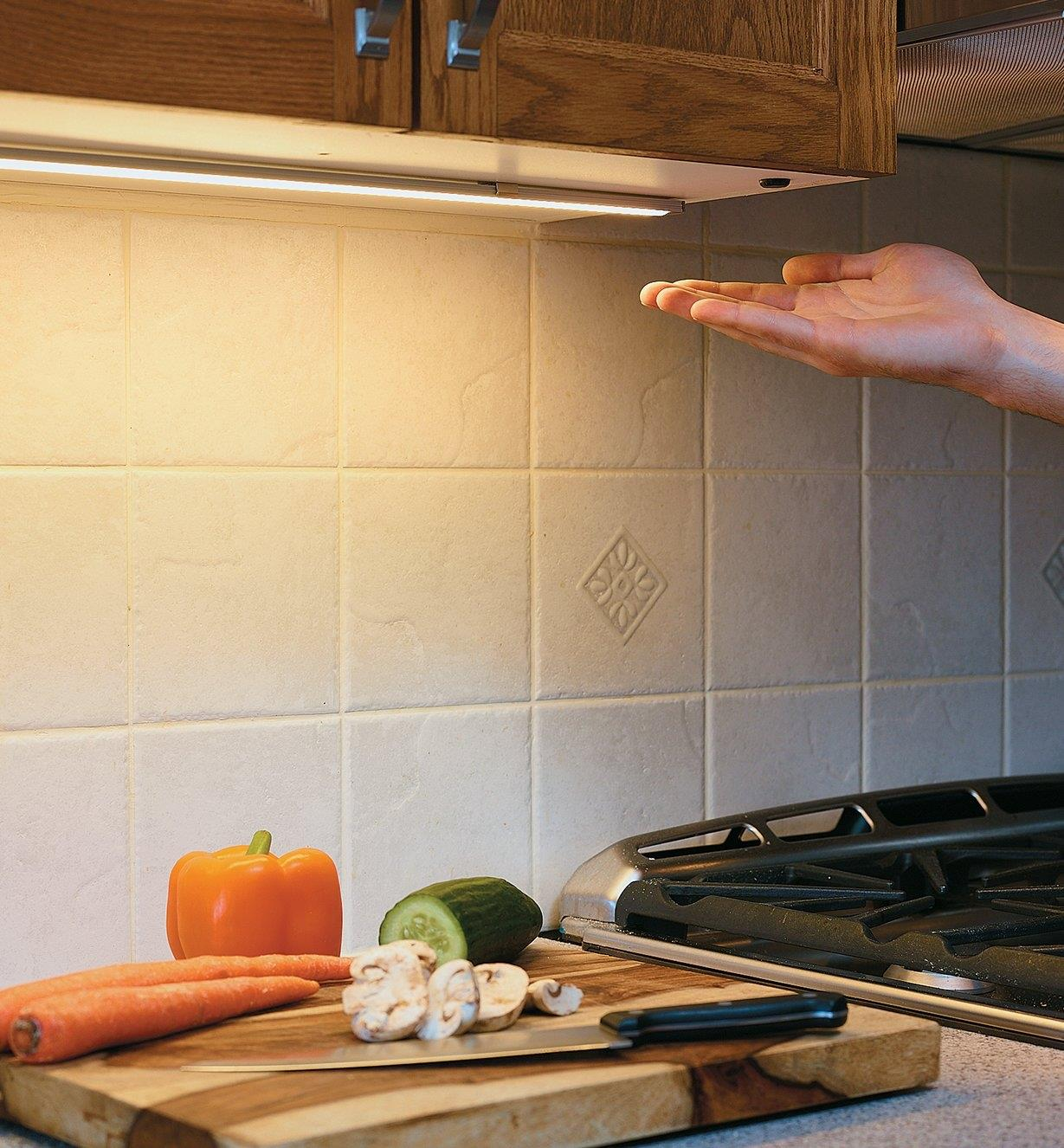 Passing a hand under a Touchless Dimmer Switch to activate LED lighting under kitchen cabinets