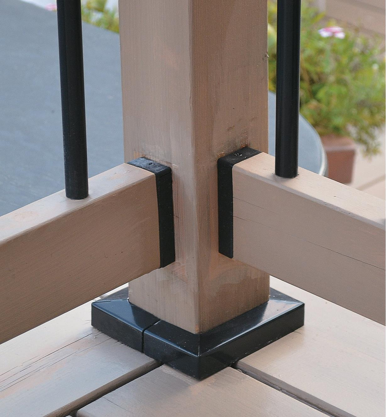 Two railings connected to a corner post with railing connectors