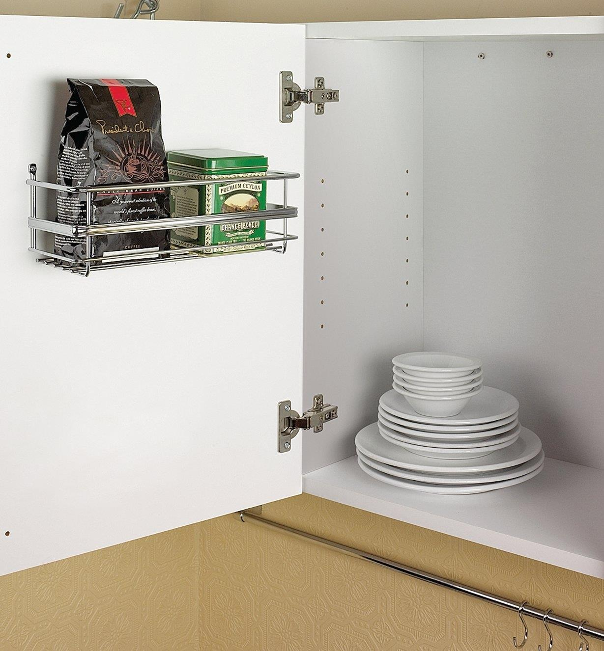 Single utility rack mounted on a cupboard door
