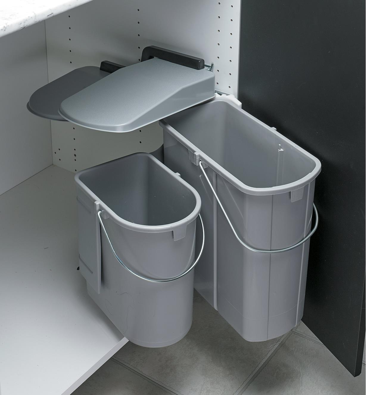 Dual Waste Bin swinging out of the cabinet as the door is opened