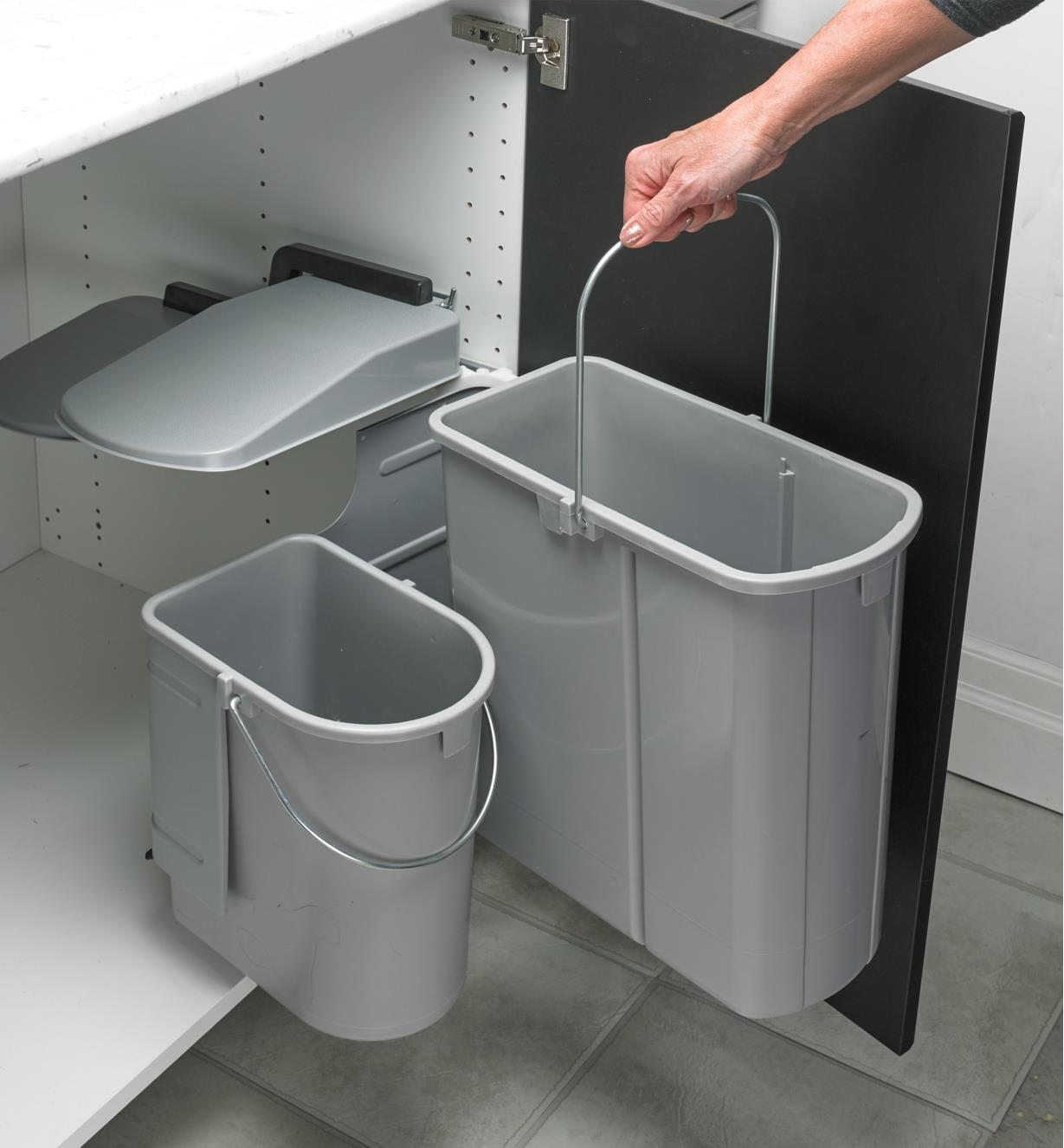 Lifting one of the waste bins by the handle