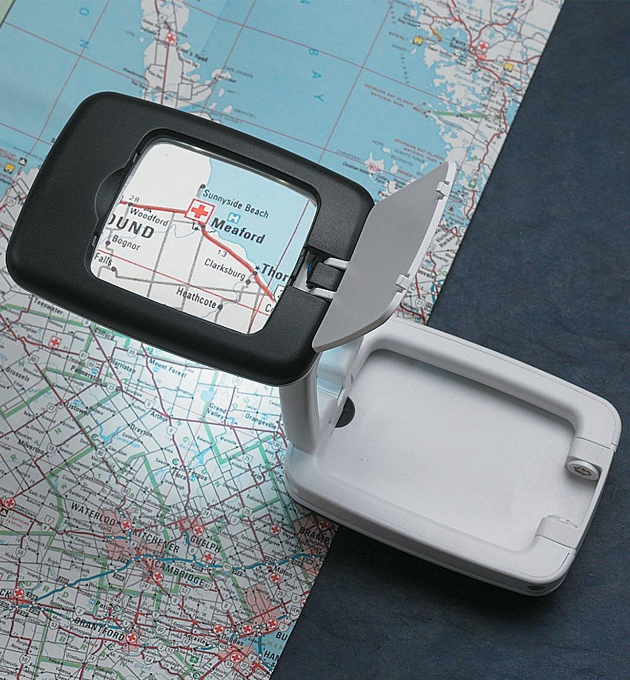 Stand-Up Folding LED Magnifier magnifying a map