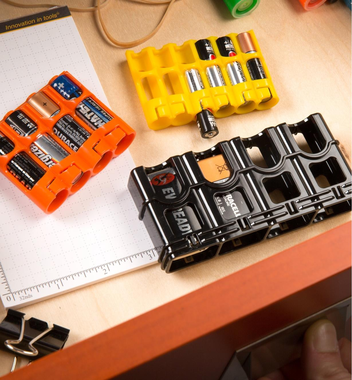 One of each size of Storacell battery caddy with batteries stored in them