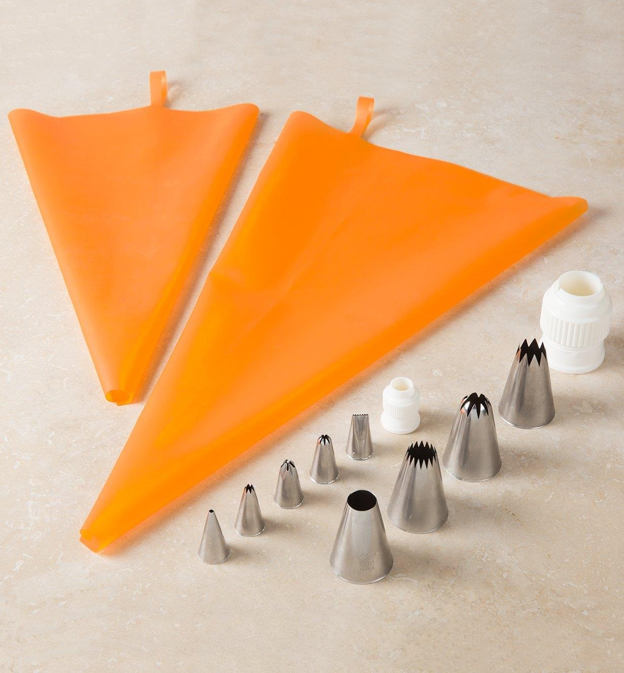 Silicone Piping Bags placed next to a selection of decorating tips and couplers