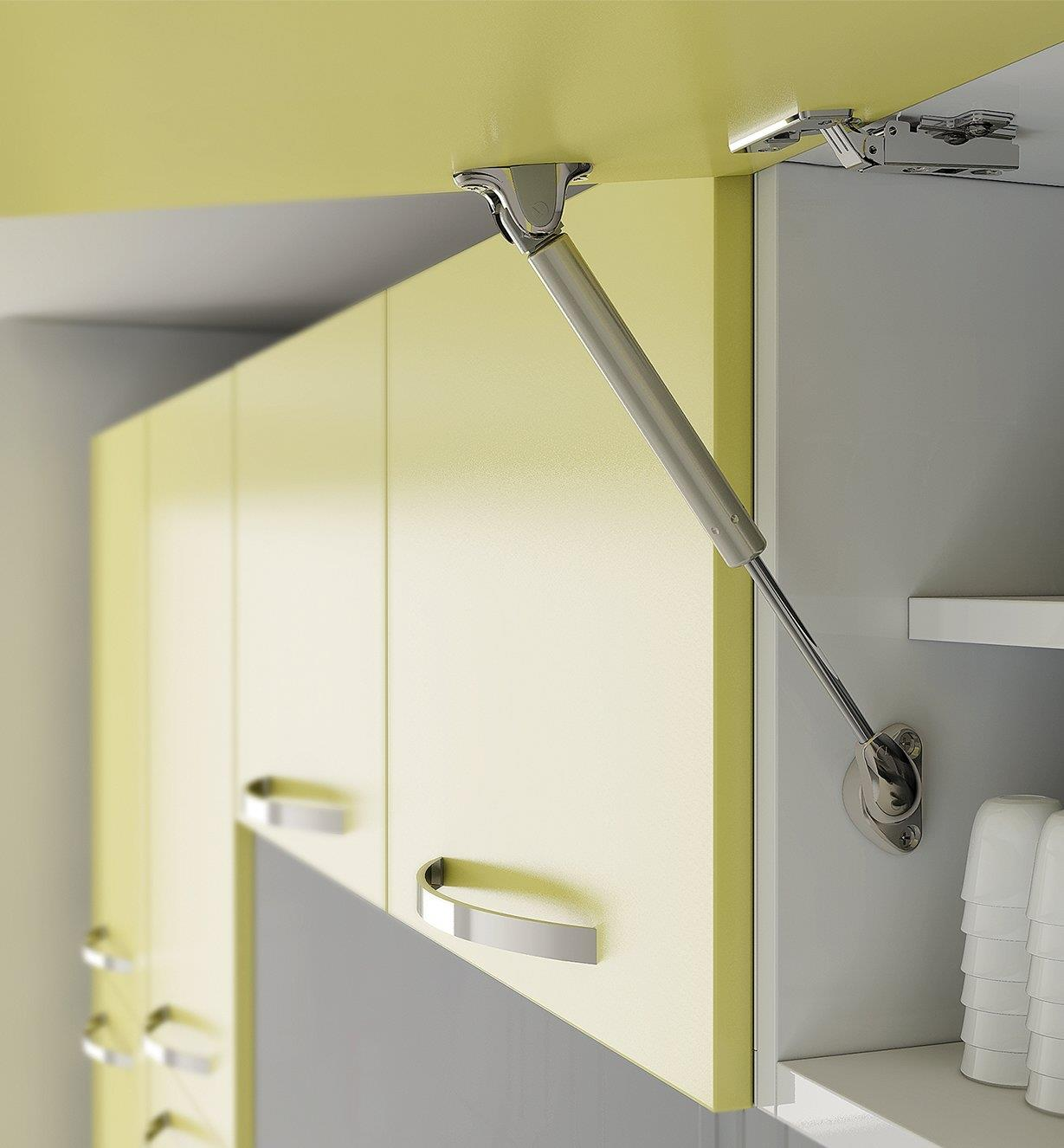 Soft-Open/Close Gas Spring Stay installed in a cabinet, holding an upward-swinging door open
