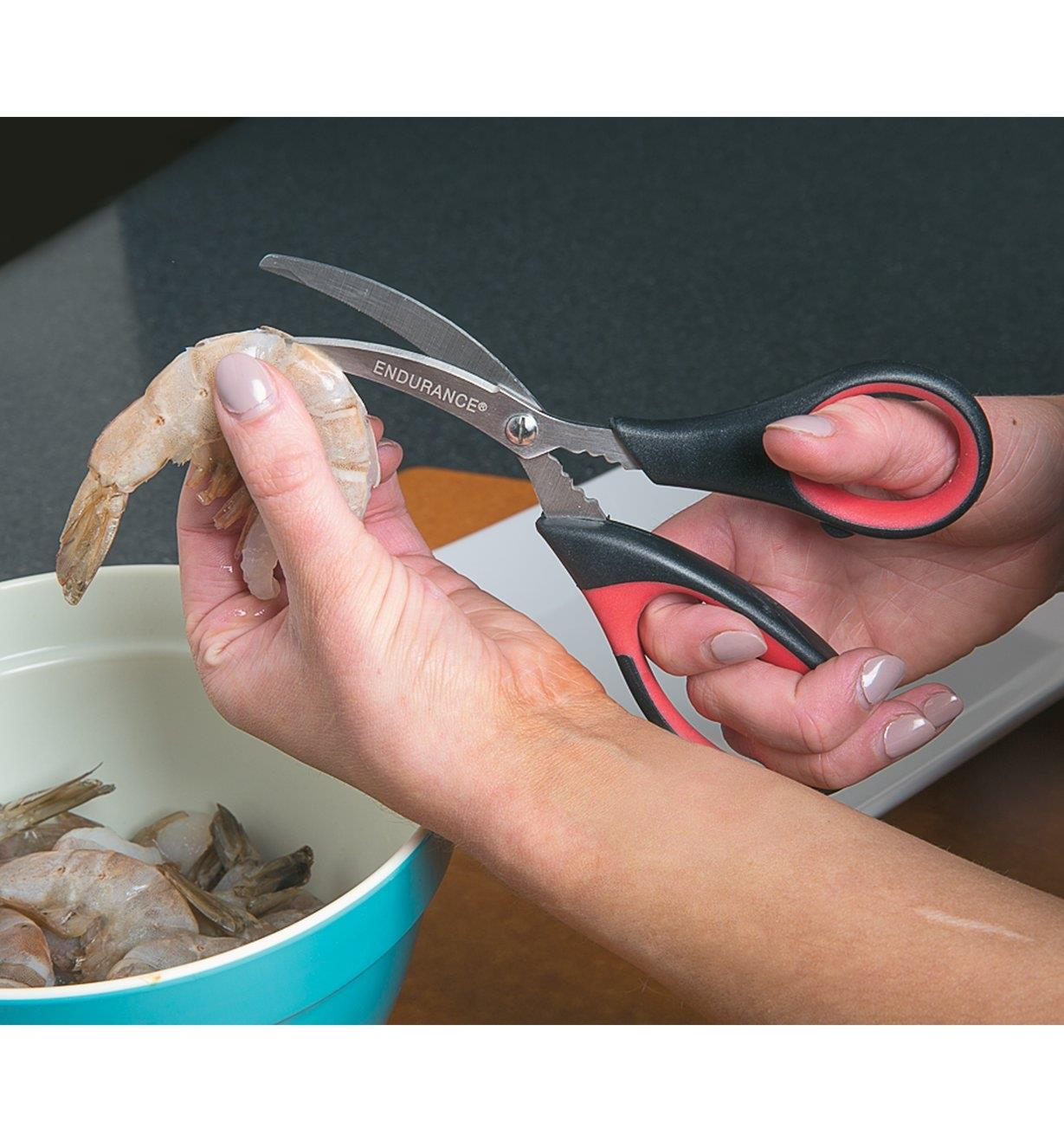 Cutting the shell of a shrimp with Seafood Scissors