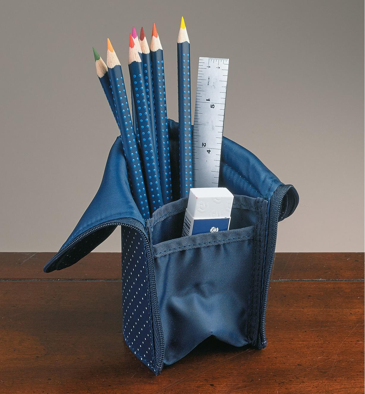 Stand-Up Pencil Case holding colored pencils, a ruler and an eraser