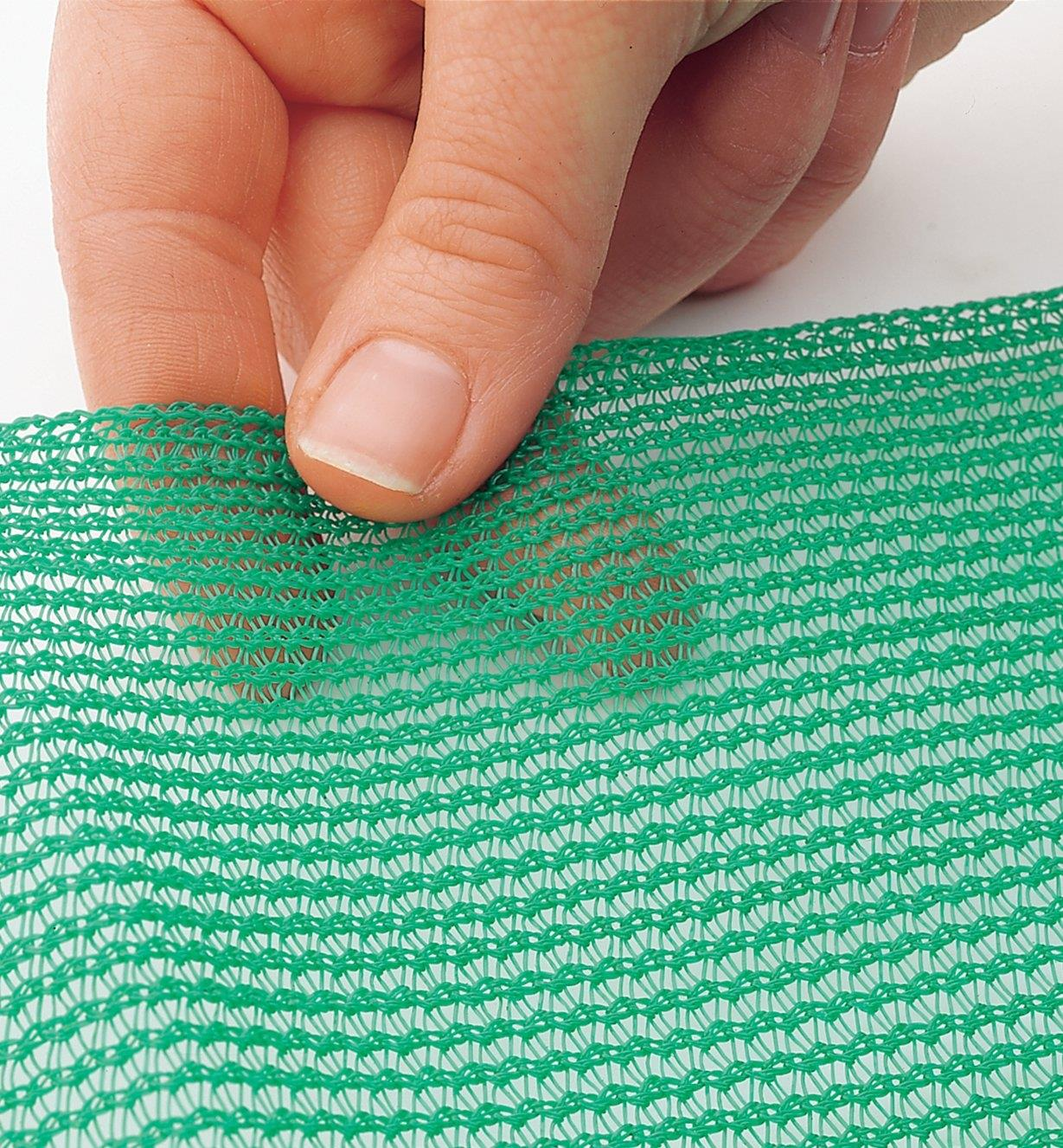 Close-up of tight-knit green material