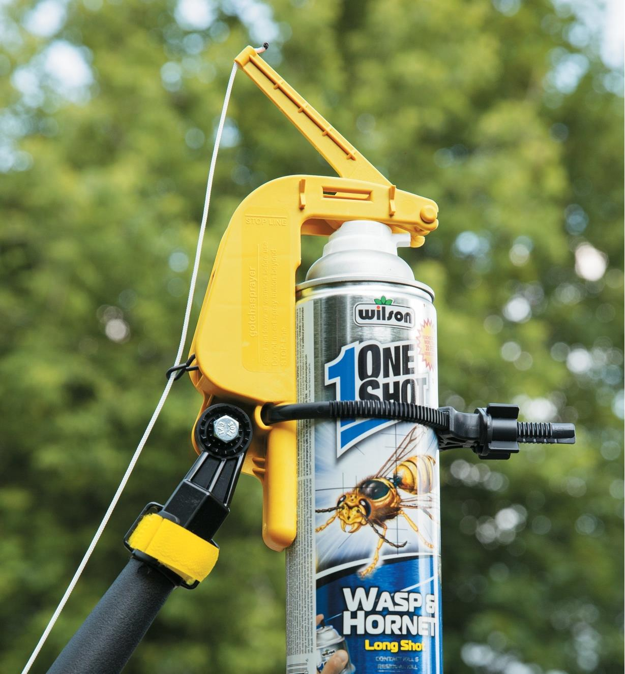 Spray can attached to a pole using the Spray-Can Pole Adapter
