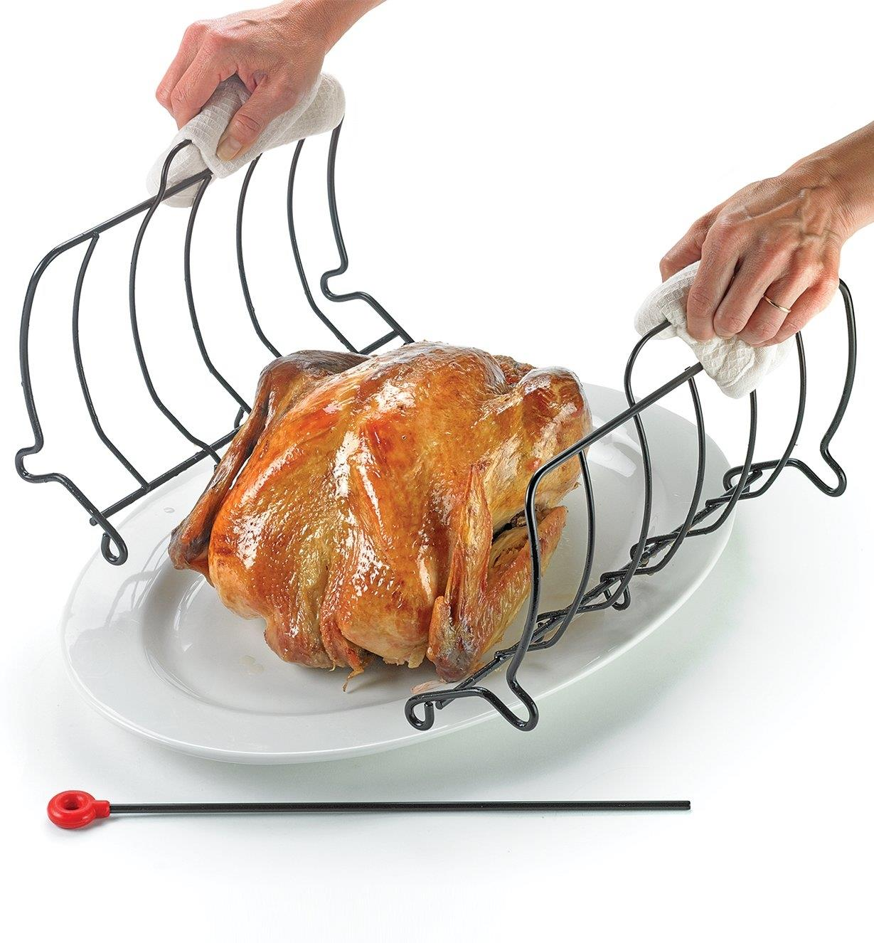 Sliding the two halves of the rack out from under the chicken on the platter