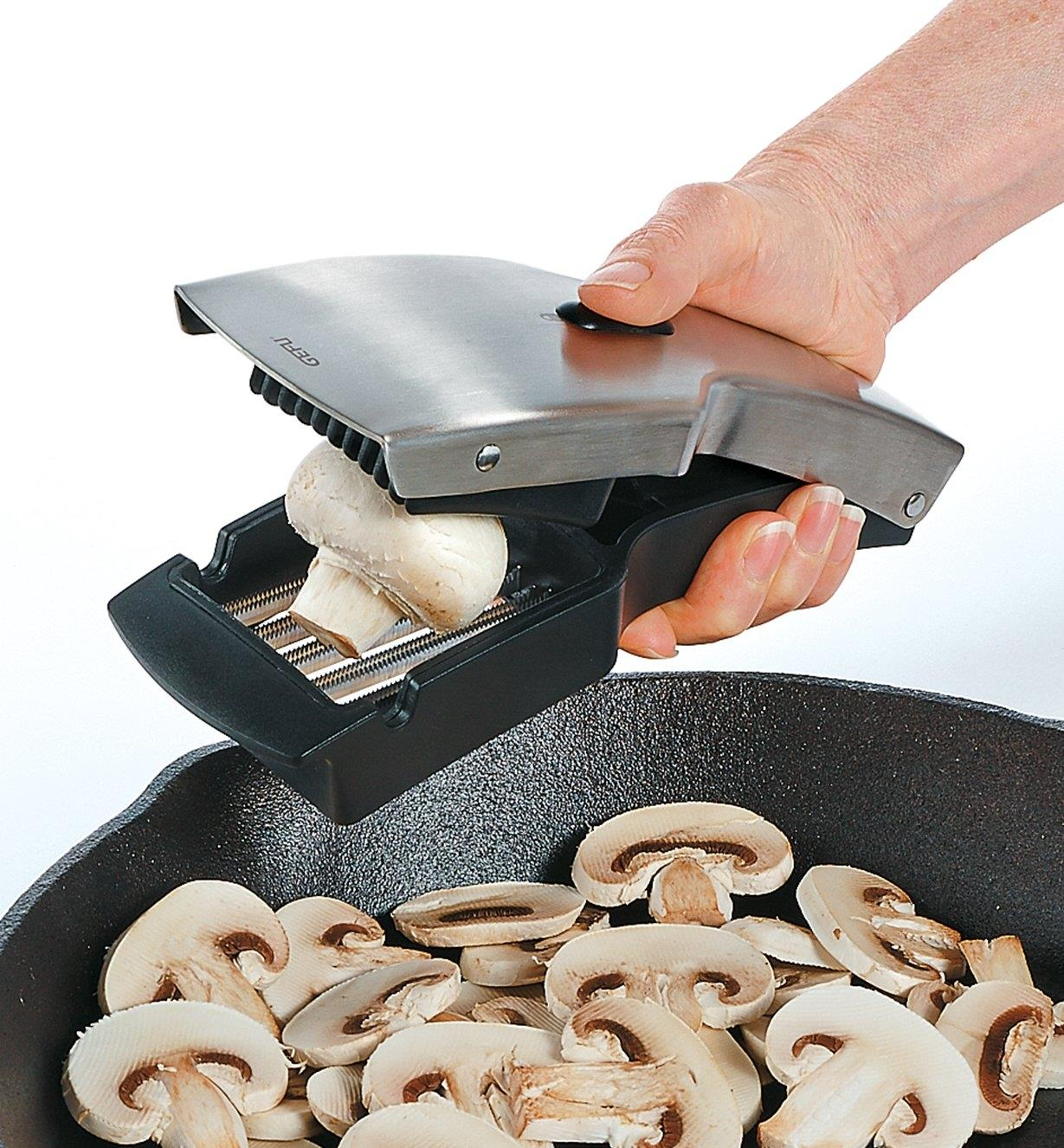 Soft Food Slicer slicing mushrooms into a frying pan