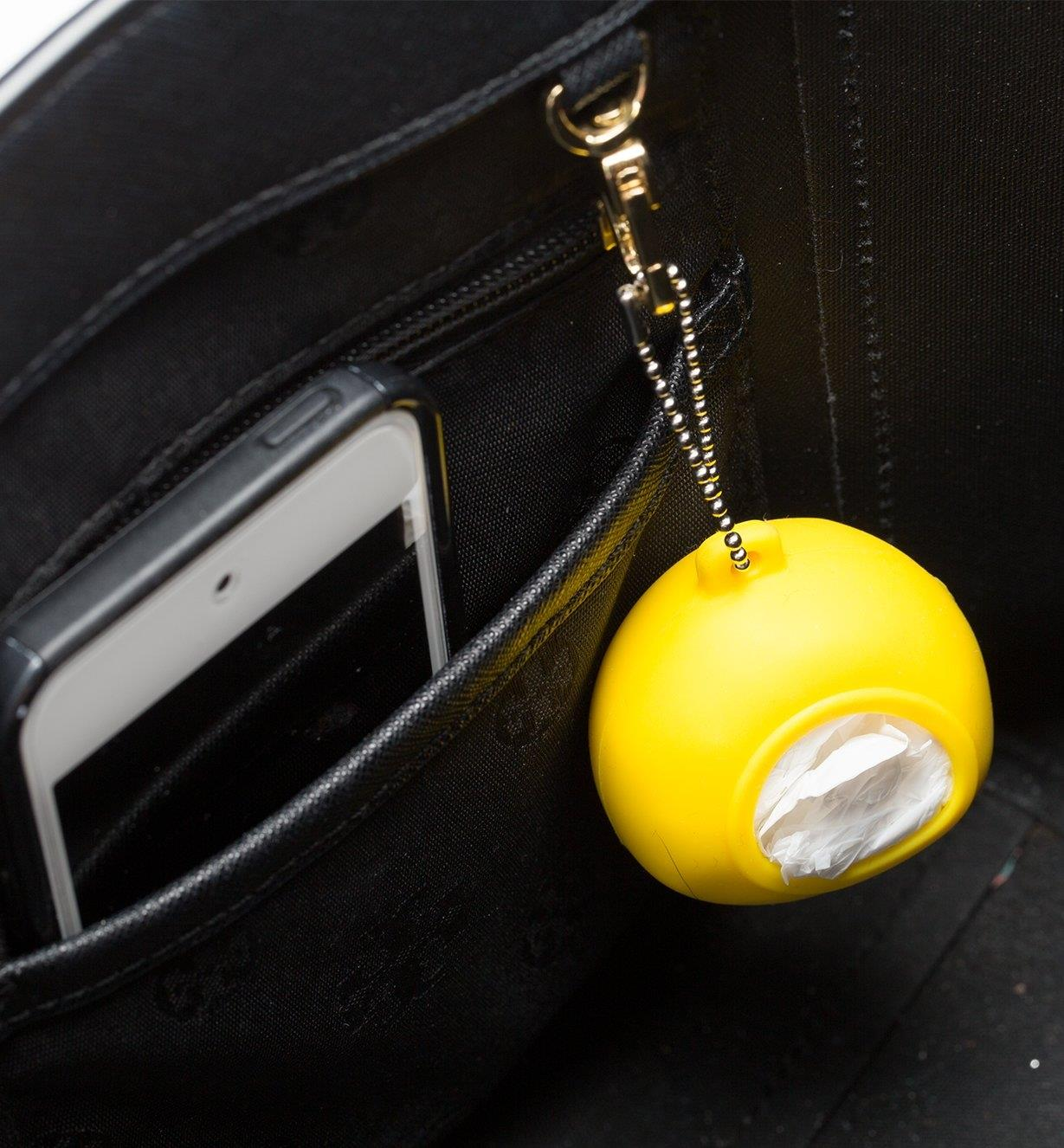 A Shopping Bag Pod attached to a hook inside a purse