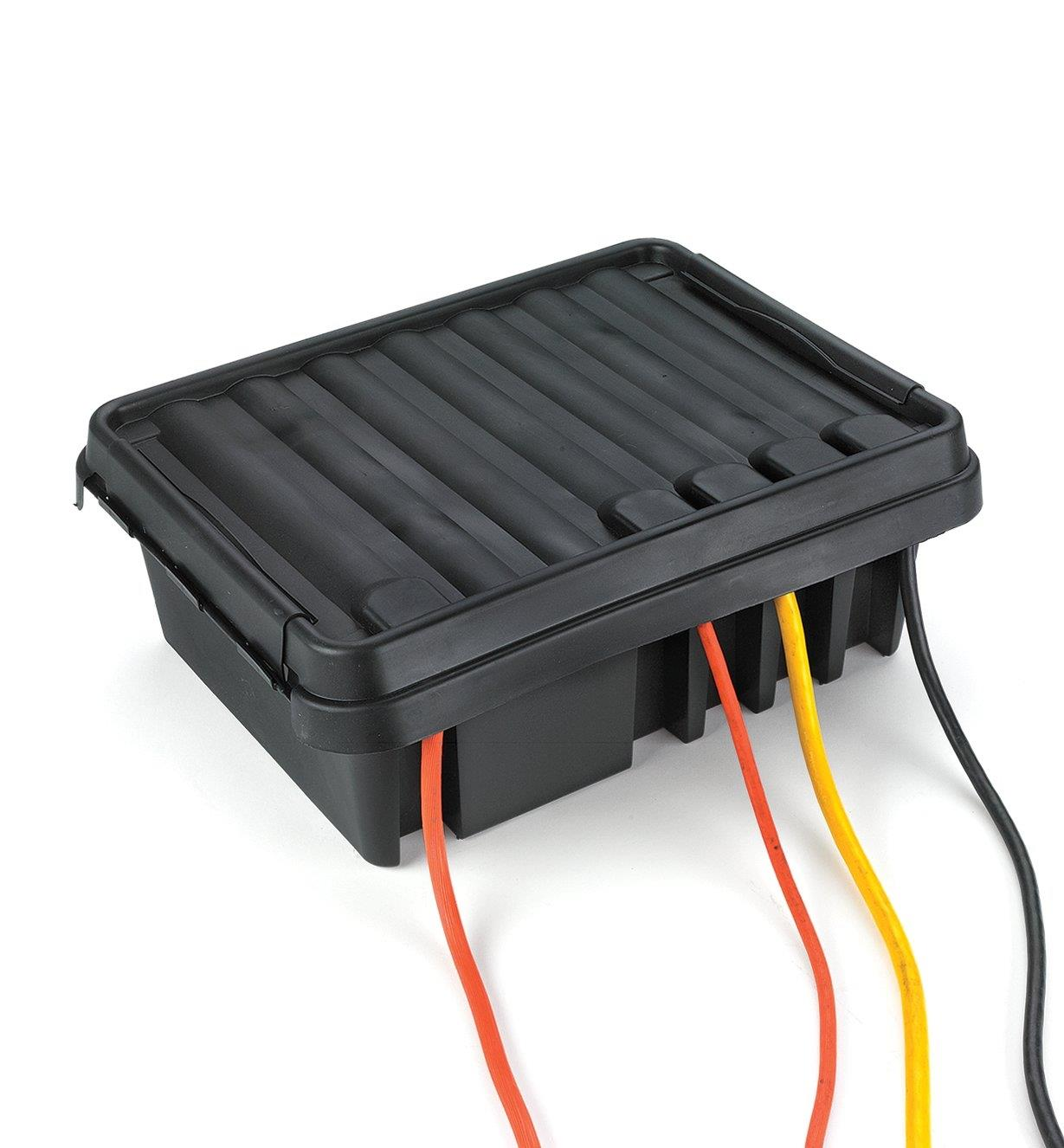 DriBox with the lid closed and power cords emerging through the ports