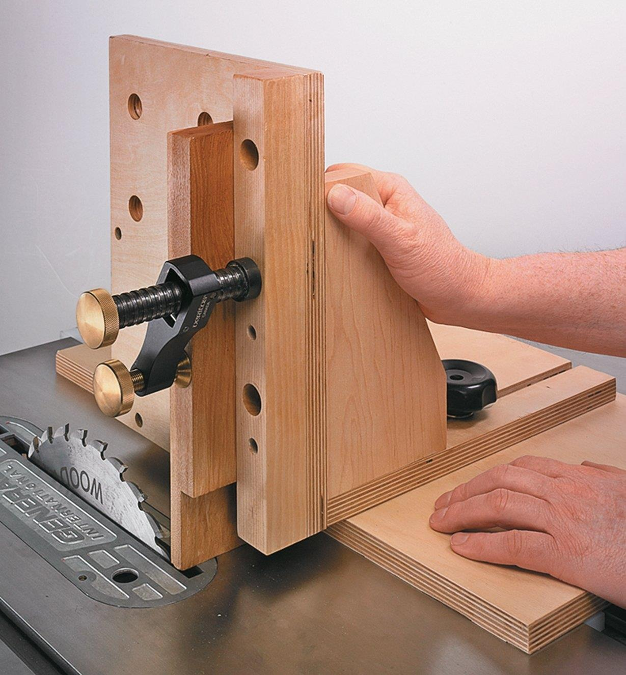 Veritas Surface Clamp holding a workpiece to a jig while cutting on a table saw